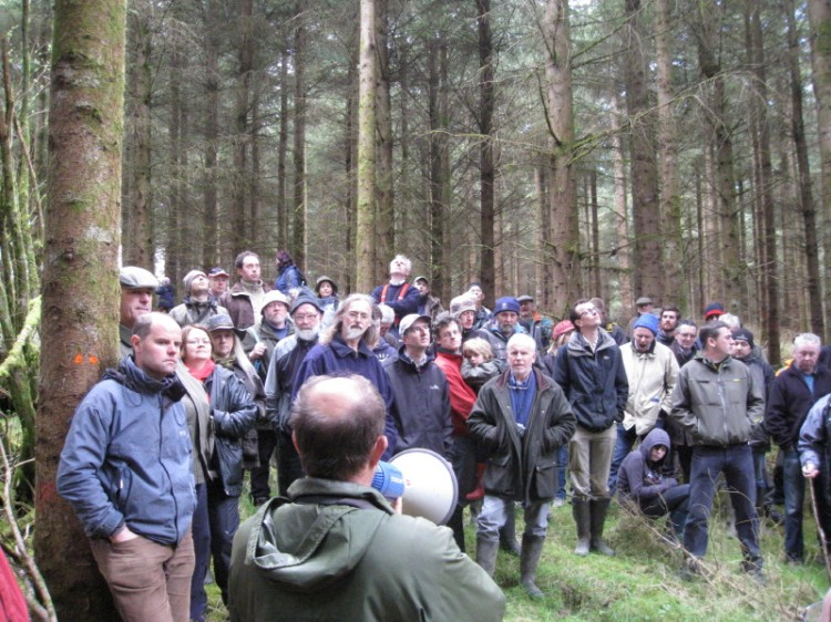 Forester Paddy Purser, ProSilva Ireland looks on as French silviculturist Marc Etienne discusses options for the Legge's High Yield Class sitka spruce plantation.